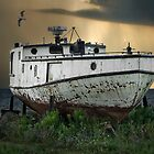 Old Fishing Boat on shore with Storm moving in by Randall Nyhof