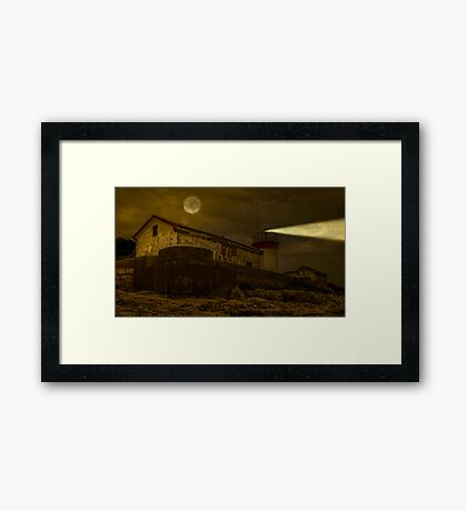 Lighthouse by night Framed Print
