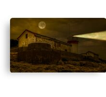 Lighthouse by night Canvas Print