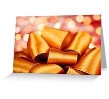 Gold gift bow with festive lights Greeting Card