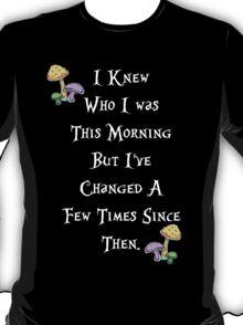 Alice in Wonderland Saying, White text. T-Shirt