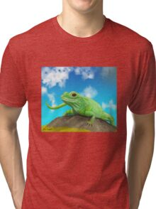 Happy Green Lizard Sitting on a Rock in a Blue Sunny Day Tri-blend T-Shirt