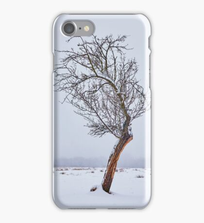 Lonely tree on snowy field iPhone Case/Skin