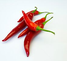 Red hot spicy peppers by John Westerveld