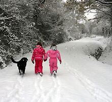 Sisters and dog on a snowy adventure by Franglais