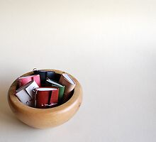 Small books in a bowl by BlueShadowM