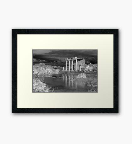 Storm clouds over ancient greek ruins Framed Print