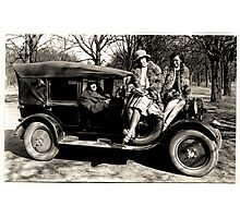 Oldmobile with girls attached Photographic Print