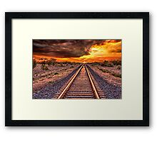 Train track to sunset Framed Print