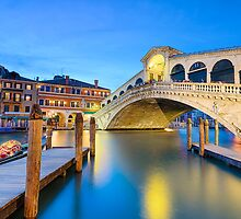 Rialto bridge at night in Venice by Michael Abid
