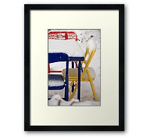 Snow Covered Colorful Chairs  Framed Print