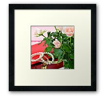 Jewel case and pink roses Framed Print