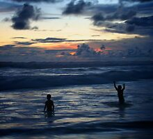 Two Boys Play in the Surf by Jon Howard
