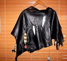 Leather cape with fishing lures.  by jordyv