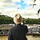 Old Man Thames feeds his flock... by MikeShort