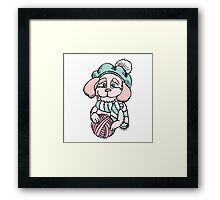 Cute puppy in beret with yarn ball Framed Print