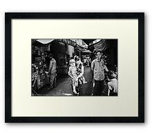 Stepping into the light. Framed Print