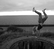 handstanding on the edge by Loise  Elisabet