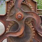 Wheels and cogs of a Victorian Mangle by Sandra Caven