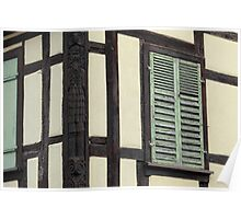 A wooden shutter on a timbered house, Alsace Poster