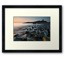 Dunstanburgh Castle at dawn Framed Print