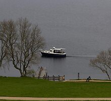 Cruise boat in Loch Ness next to Urquhart Castle by ashishagarwal74