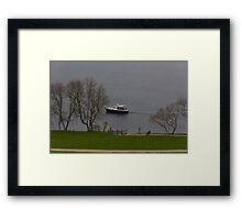 Cruise boat in Loch Ness next to Urquhart Castle Framed Print