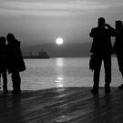 silluets in the sunset in b&w by mkokonoglou