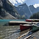 Canoes on the Dock, Lake Morraine by aMillionWordsCa