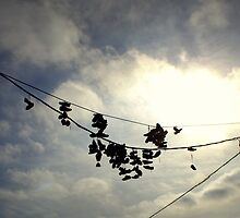Hanging By A Shoelace  by Nick Brewer