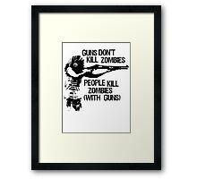 Guns don't kil zombies, People do! Framed Print