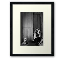 Girl and her rainboots Framed Print
