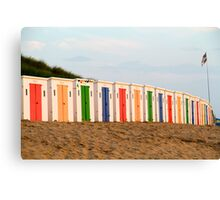 Coloured beach huts at Woolacoombe Canvas Print