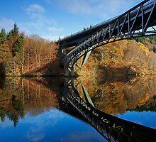 Autumn colours surround Loch Faskally Bridge Scotland by Martin Lawrence