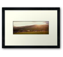 Sunset, village and rolling hills Framed Print