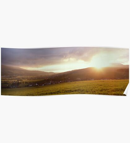 Landscape filled with golden light at sunset Poster