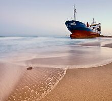 Wrecked ship ashored in Sharjah - Ajman beach on the cost of Persian Gulf by naufalmq