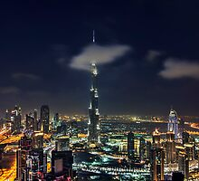 Scattered clouds passing by Burj khalifa and the downtown Dubai by naufalmq