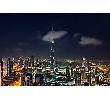 Scattered clouds passing by Burj khalifa and the downtown Dubai Photographic Print