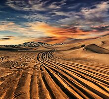 Dubai desert with beautiful sandunes during the sunrise by naufalmq