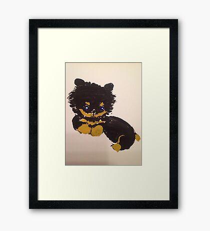 Little furry cute puppy Framed Print