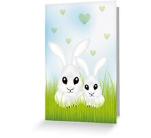 Adorable Easter rabbits in green grass Greeting Card