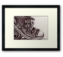 Leather, buckles and a Tin Can Framed Print