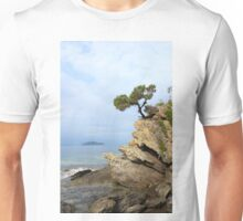 pine tree on a rock above the sea Unisex T-Shirt
