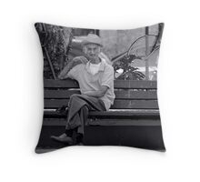 Old man at the town square bench Throw Pillow