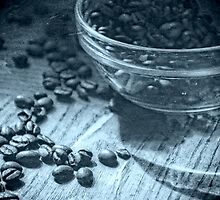 glass bowl of roasted coffee beans by roastberry