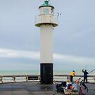 Fishing on the pier of Nieuwpoort, Belgium by 7horses