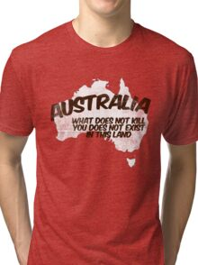 Australia: What does not kill you does not exist in this land Tri-blend T-Shirt