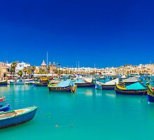 Fishing boats on turquoise sea by LacoHubaty