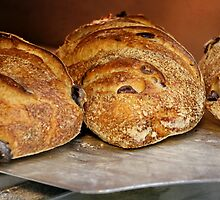 Freshly baked bread in an electric oven  by PhotoStock-Isra